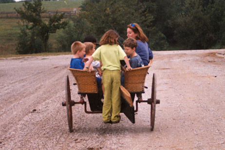 Jan Mactier  gives the next generation of riders a lift in the pony cart.